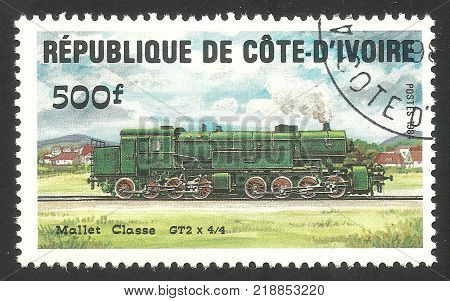 Cote d'Ivoire - CIRCA 1984: Stamp printed by Cote d'Ivoire Multicolor memorable edition offset printing on the topic of Railway and Trains shows Locomotive Mallet class GT2