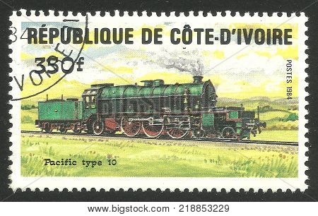 Cote d'Ivoire - CIRCA 1984: Stamp printed by Cote d'Ivoire Multicolor memorable edition offset printing on the topic of Railway and Trains shows Locomotive Pacific type 10