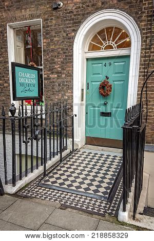 LONDON UK - 18 DECEMBER 2017: The main entrance and information signage to the Charles Dickens Museum housed in the authors former home on Doughty Street Holborn London.