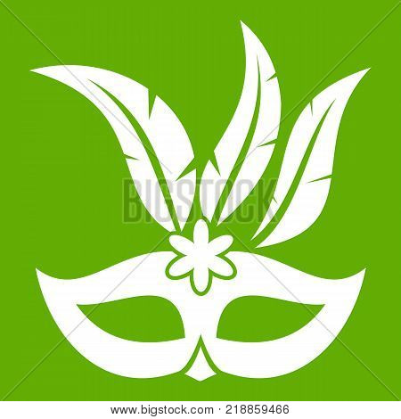 Carnival mask icon white isolated on green background. Vector illustration
