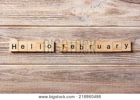 Hello February word written on wood block. Hello February text on table concept.