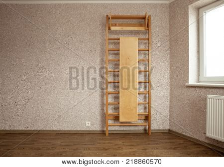 empty room for gymnastics with wall mounted gym ladder