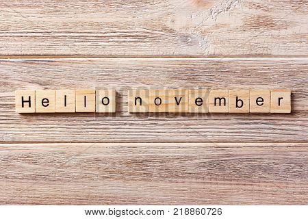 Hello November word written on wood block. Hello November text on table concept.