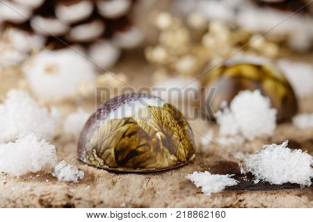 Colored Handmade Chocolate Candies On Wooden Background