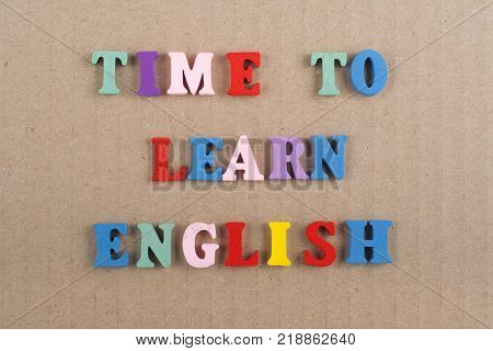 TIME TO LEARN ENGLISH word on background composed from colorful abc alphabet block wooden letters, copy space for ad text. Learning english concept