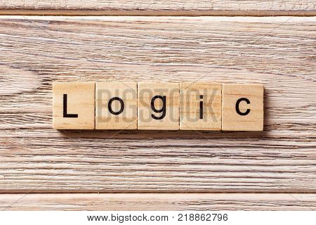 Logic word written on wood block. Logic text on table concept.
