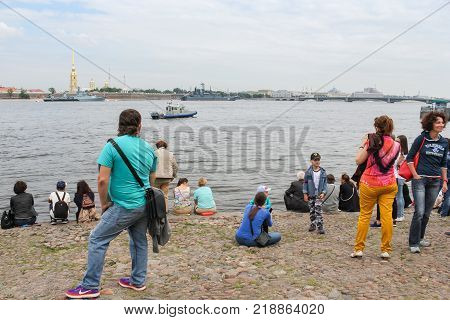 St. Petersburg, Russia - 28 July, The people watching the parade, 28 July, 2017. Festive parade of warships on the Neva River in St. Petersburg.