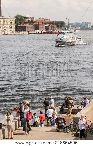 St. Petersburg, Russia - 28 July, People watching the military parade, 28 July, 2017. Festive parade of warships on the Neva River in St. Petersburg.