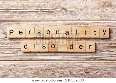 Personality disorder word written on wood block. Personality disorder text on table concept.