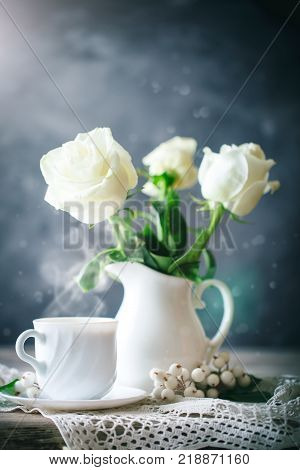 Valentines day card. Mother's day. Womans day. Still life with white roses and coffee on a wooden table. Selective focus