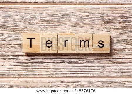 Terms word written on wood block. Terms text on table concept.