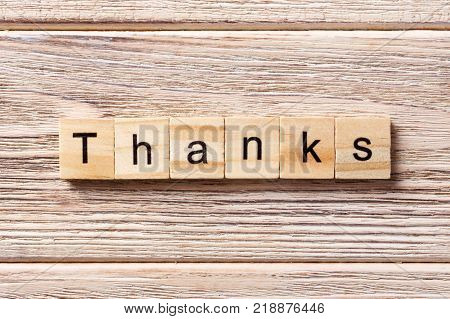 thanks word written on wood block. thanks text on table concept.