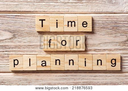 Time for planning word written on wood block. Time for planning text on table concept.
