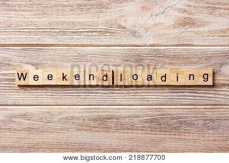 Weekend Loading word written on wood block. Weekend Loading text on table concept.