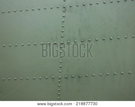 Rows of rivets of an airplanes fuselage