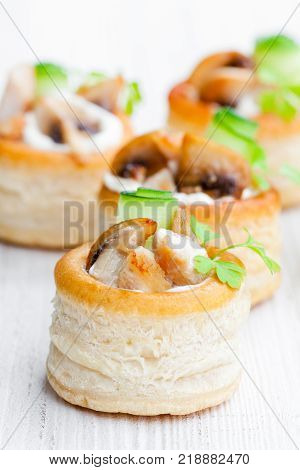 Vol-au-vents Puff Pastry Cases Filled With Mushrooms And Chicken Breast On White Background