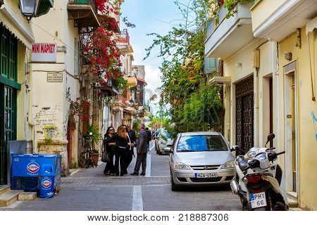 Rethymno Greece - May 3 2016: Walk around the old resort town Rethymno in Greece. Architecture and Mediterranean attractions on island Crete. Narrow touristic street in the tourist routes