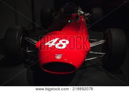 London United Kingdom - October 29 2017: Harris-Costin Protos Formula Two racing car with spare plywood body 1967 designed by Frank Costin stands in dark hall