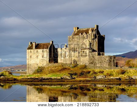 Eilean Donan Castle with water reflection at dusk