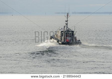 New Bedford Massachusetts USA - December 15 2017: Pilot boat Northeast Pilot II heads into Buzzards Bay from New Bedford