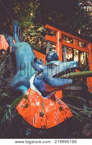 Fox purification fountain at Fushimi Inari Taisha torii shrine Kyoto Japan poster