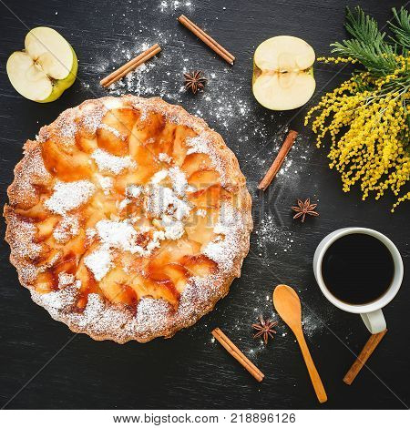 Apple cake, fruits and coffee cup on dark background. Flat lay, Top view.