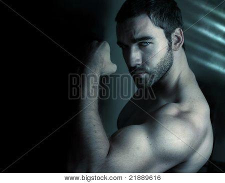 Stylized portrait of macho man flexing bicep with tattoo reading