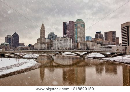 The Columbus, Ohio skyline along the Scioto River waterfront on a snowy day