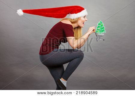 Santa Woman Holding Shopping Cart With Christmas Gifts