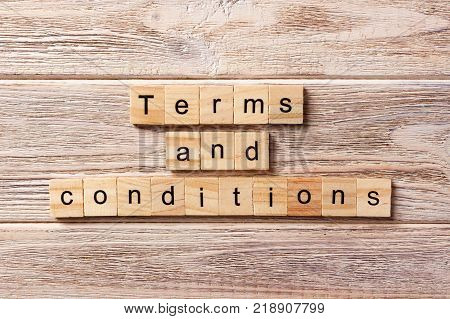 Terms and Conditions word written on wood block. Terms and Conditions text on table concept.
