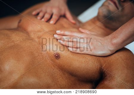 Chest Massage,physical Therapyst Massaging Chest Of Male Athelete