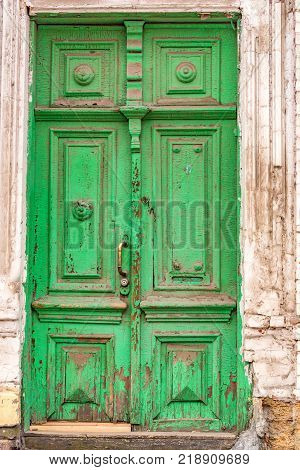 Ancient weathered obsolete green door in Rostov-on-Don