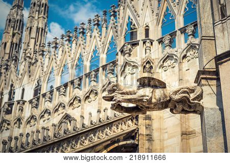 Gargoyle is on the roof of the Milan Cathedral (Duomo di Milano) in Milan Italy. Milan Duomo is the largest church in Italy and the fifth largest in the world.