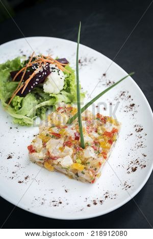 gourmet asian fusion cuisine marinated raw tuna tartare with spicy tropical mango lime sauce meal