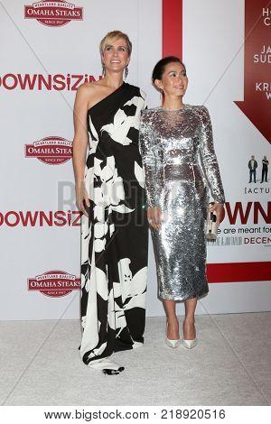 LOS ANGELES - DEC 18:  Kristen Wiig, Hong Chau at the