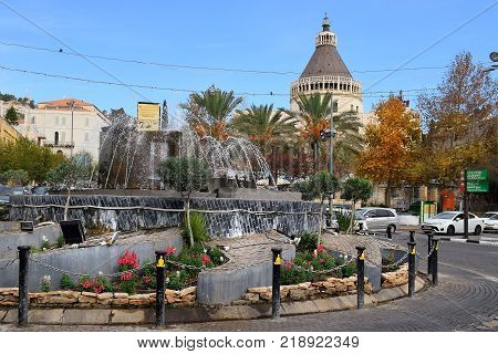 NAZARETH, ISRAEL - DECEMBER 18: fountain in front of the Basilica of the Annunciation in Nazareth, Israel. This church was built on the site where according to Tradition was the home of the Virgin Mary, december 18, 2017