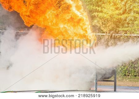 Firefighter trainingInstructor training how to use a fire extinguisher for fighting fire