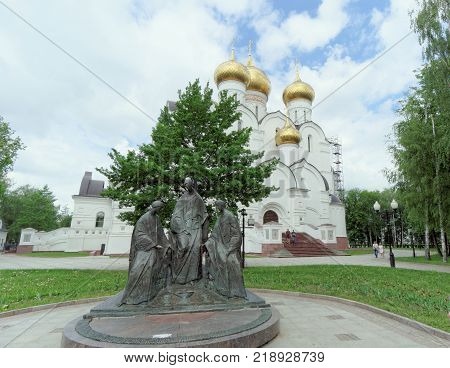 Yaroslavl, Russia. - June 3.2016. Sculptural composition of the Trinity on the background Assumption Cathedral