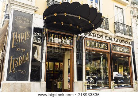 LISBON, PORTUGAL - September 25, 2017: Front windows of the centenary Fashion Shop in Chiado old quarter of Lisbon Portugal Translation: PARIS IN LISBON FASHION - INNOVATION - CLOTHING