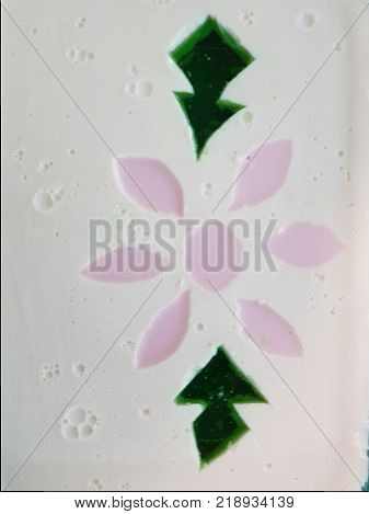 Milk gelatin with poinsettia flower figure, textured background