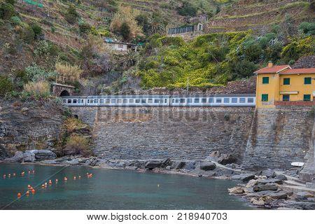 Train on the Ligurian coast in Cinque Terre Italy.