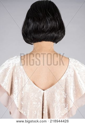 Back View of a Woman with Shiny Short Black Hair