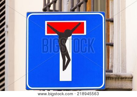 Road sign with a crucified man street art metropolitan art poster
