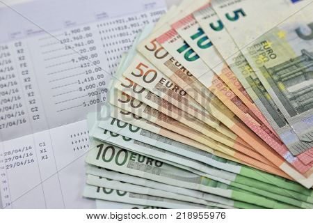 Many euro banknotes and bank account passbook show a lot of transactions. concept and idea of saving money investment interest bank loan inflation expenses