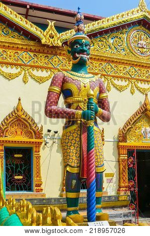 Malaysia August 2008 located at Pulau Tikus in George Town this is the only Burmese Buddhist temple Dhammikarama in Penang state in Malaysia and in the summer also tourists visit it. This is guardian deity sculpture called Yaksha