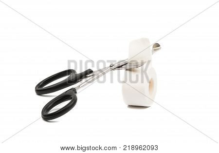 adhesive plaster with scissors isolated on white background
