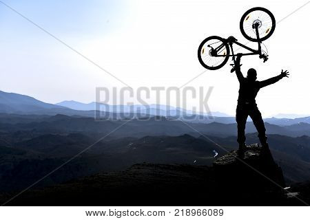 cross the majestic mountains with bicycles & biker and success explorer