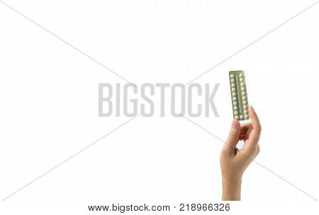 Asian young woman holding pack of contraceptive pills with one hand isolated on white background with copy space and clipping path. Choosing family planning with birth control pill concept