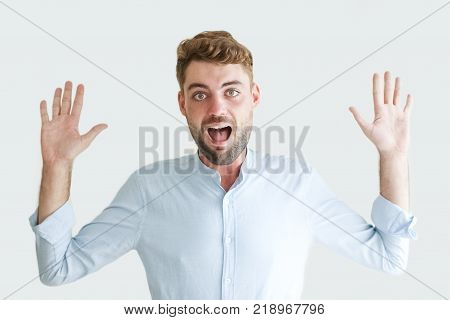 Portrait of surprised and irritated handsome young man showing both palms. Businessman with keeping hands off gesture. Surprise and conflict concept
