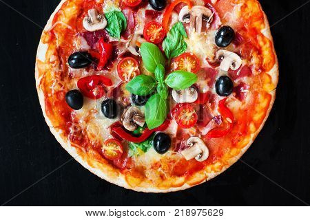 Hot pizza with Pepperoni Sausage on a dark background with copy space. Cheese Pizza